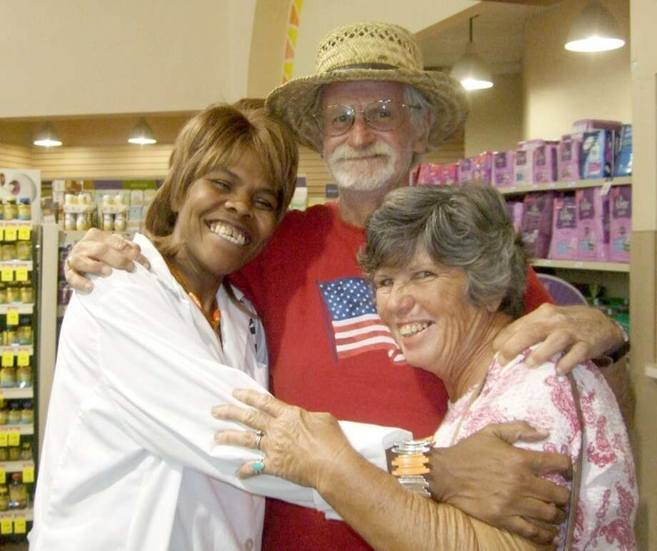 Nurse Vivian Finch and patients Dale and Carol Redd embrace after Finch was able to find shingles vaccine for them in Plainview. The Redds were concerned a third bout with shingles could kill Carol, but after making calls to multiple cities looking for the vaccine they were about to give up until Finch found some. Photo: Shanna Sissom/Plainview Herald