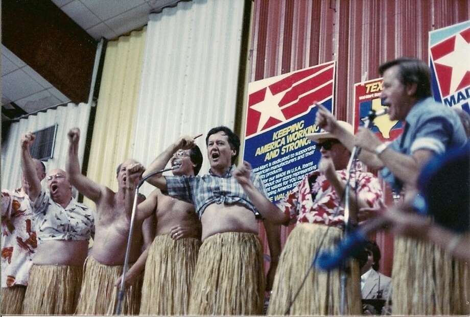 Members of the local industrial foundation come through on a promise to perform a hula dance for Walmart founder Sam Walton if he chose to locate a distribution center in Plainview. Among those pictured is J.B. Roberts (center.)