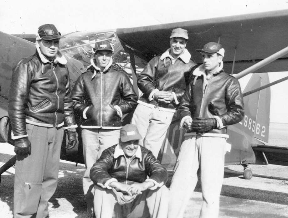 Leighton H. Maggard of Plainview (left) provided this photograph of him and four other pilots, including Jay McPherson (right) at the Plainview Pre-Glider School in 1943. The photograph shows a Piper L-4 single-engine plane, which was used for training, in the background.