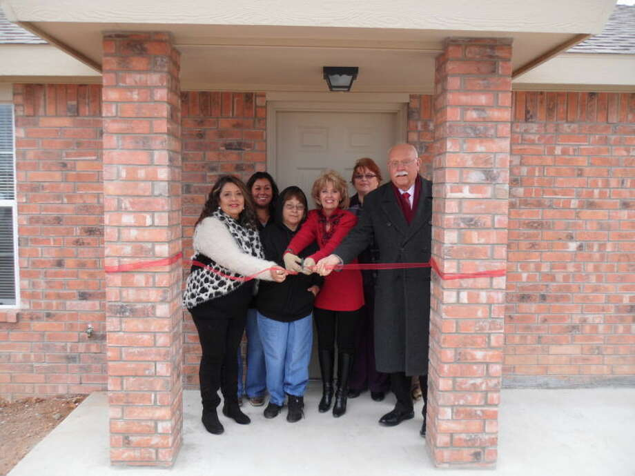 Brad Patrick/South Plains Community Action AssociationTaking part in a ribbon cutting ceremony in Lockney on Friday are SPCAA Board Member Rosie Rendon (left), SPCAA HOME Program Specialist Christy Vargas, homeowner Eustolia Gonzales, Floyd County Judge Penny Golightly, Floyd County Treasurer Jo Elliot and SPCAA Executive Director Bill Powell