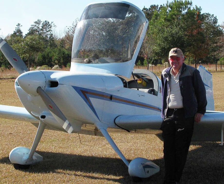 "Courtesy PhotoJoseph ""Dann"" Fabianstands beside his RV6 plane. His house has a runway in the front yard."