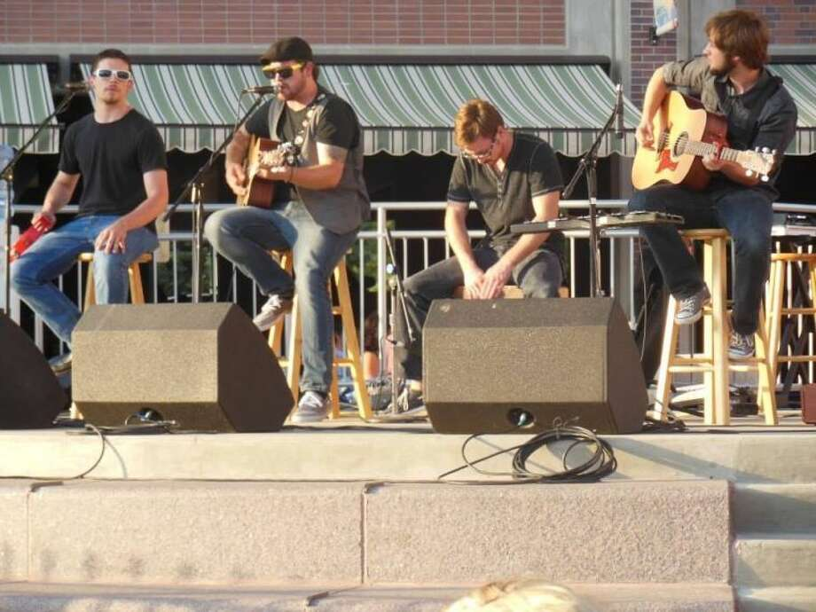 Courtesy PhotoDusty Ledbetter (second from left) and his band, Climbing Blind, perform at the Hills Alive festival in Rapid City, S.D. The band hopes to hit the road in 2014 for full-time music ministry.