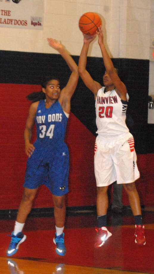 Plainview's Taivia Hearn (20) shoots over Palo Duro's Ajahn Harvey (34) in a game Friday night. Hearn leads the Lady Bulldogs in rebounding as they begin to gear up for District 4-4A play, which opens a week from Friday. Photo: Skip Leon/Plainview Herald