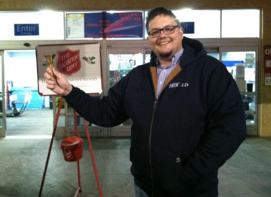 The Herald's Ryan Crowe enjoys his time ringing a Salvation Army bell Saturday at the Walmart Supercenter. Photo: Alfonso Martinez/Salvation Army