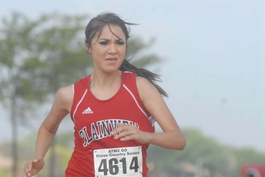 The Plainview Lady Bulldogs' Janely Gonzalez sprints to the finish line during the Plainview Invitational cross country meet at Running Water Draw Regional Park on Saturday. The Lady Dogs placed sixth out of nine teams while the Bulldogs took first. Photo: Ryan Thurman/Plainview Herald