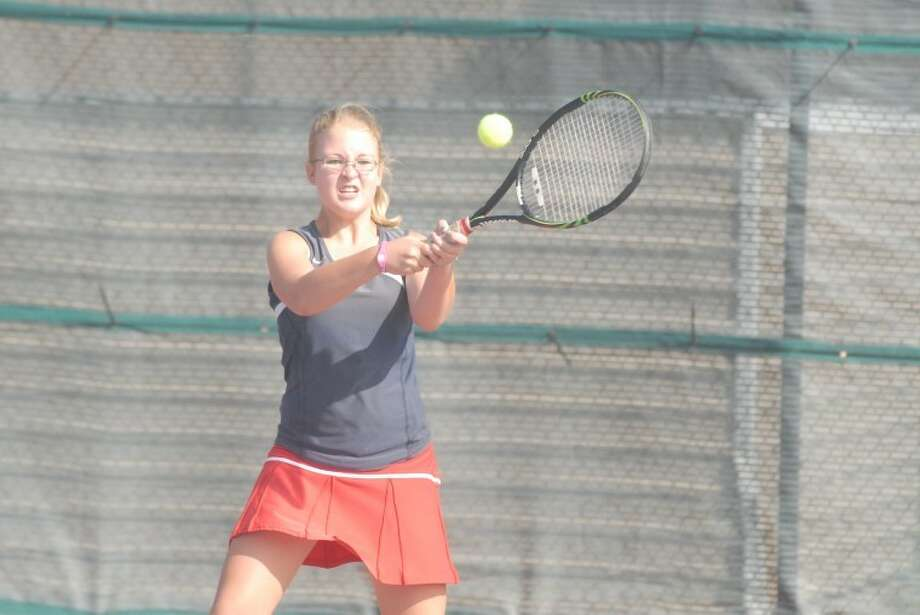 The Plainview Lady Bulldogs' Jennifer Hollars hits a backhand during a District 3-4A singles match Saturday against Hereford. Photo: Ryan Thurman/Plainview Herald