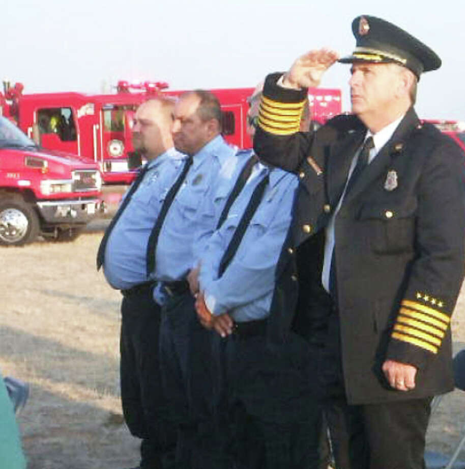 Plainview Fire Chief Rusty Powers salutes during the National Anthem at Friday's salute to First Responders sponsored by American State Bank in Runningwater Draw Regional Park. (See video at www.MyPlainview.com)