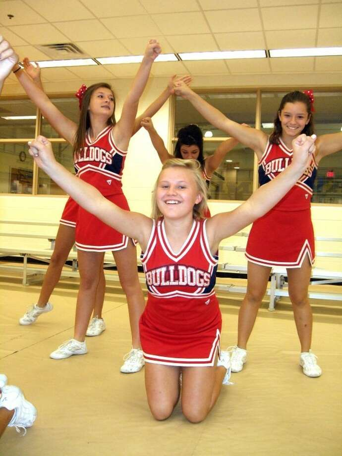 "Plainview High School cheerleaders - including freshmen Kaylee Moreno (left), Lacey Perkins (front), Macie Calderon (back) and Ashton Espinoza - fired up the audience at today's Plainview Area United Way Kickoff Breakfast/Pep Rally at Wayland's Laney Center. More than 300 people heard KCBD-TV's Abner Euresti and Karin McCay speak about the importance of being a team. The campaign's theme is ""Teaming Up For Our Community,"" and the fundraising goal for 12 member agencies is $425,000. (See video at www.MyPlainview.com) Photo: Kevin Lewis/Plainview Herald"