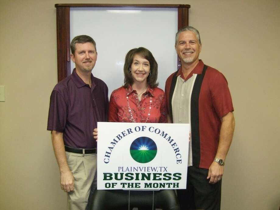 Lewis, Kaufman and Co. PC was honored as the Plainview Chamber of Commerce Business of the Month. Representing the accounting firm are Thad Reid (left), Lea Stukey and Randy Kaufman. Partners not pictured are Martin Lewis and Lori Gattis. The firm, founded in the mid-1970s, has 17 full-time and two part-time employees. Photo: Kevin Lewis/Plainview Herald