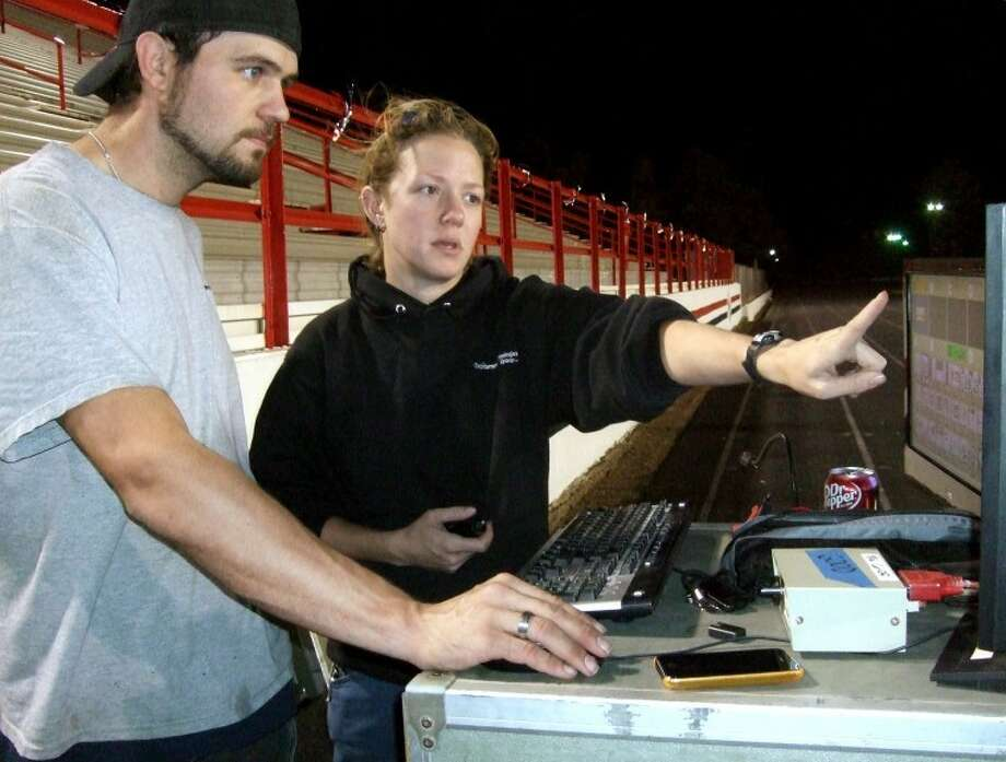 Matt Roelfs and Dani Sawtell of Excitement Technologies Group of Dallas work Wednesday night to set up the laser light show that will be the feature attraction at tonight's homecoming pep rally, which begins at 7:30 p.m. in Greg Sherwood Memorial Bulldog Stadium. Officials expect an overflow crowd in the west stands of more than 4,000 people. Admission is free. Photo: Kevin Lewis/Plainview Herald