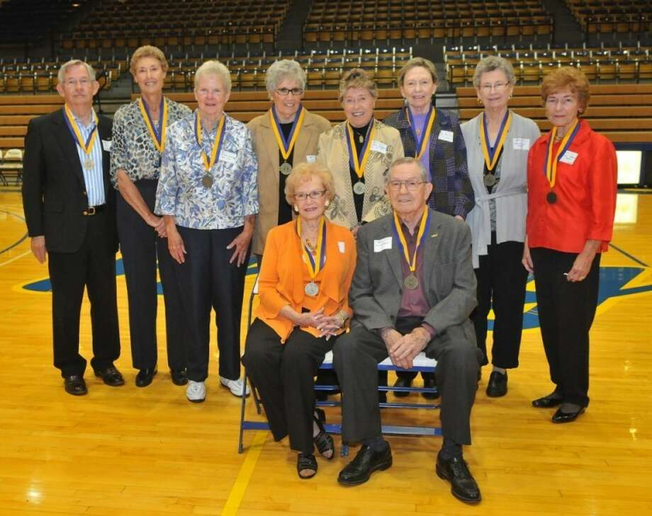 """Among those honored at Friday's Flying Queens reunion were (back, from left) Mike Hutcherson, Judy Bugher, Carla Lowry, Mona Poff, Alice """"Cookie"""" Barron, Rita Alexander, Oma Gean Capps, Georgie Bryant; (front) Wilda and Harley Redin. Photo: Wayland Baptist University Photo"""