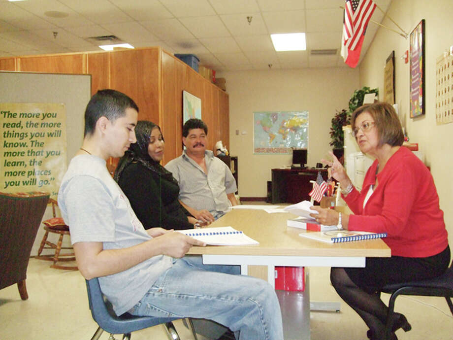 Lydia Castillo met with the three students for one-on-one tutoring sessions until they were ready to take the U.S. citizenship exam. Castillo is at right. Across from her, far to near, are Hilario Garcia, Halimo Ali and Felipe de Jesus Chairez. Photo: Gail M. Williams | Plainview Herald