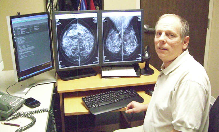 Dr. Jay Scherr, a diagnostic radiology specialist, demonstrates computer-aided detection of suspicious areas of the breast. Photo: Gail M. Williams / Plainview Herald