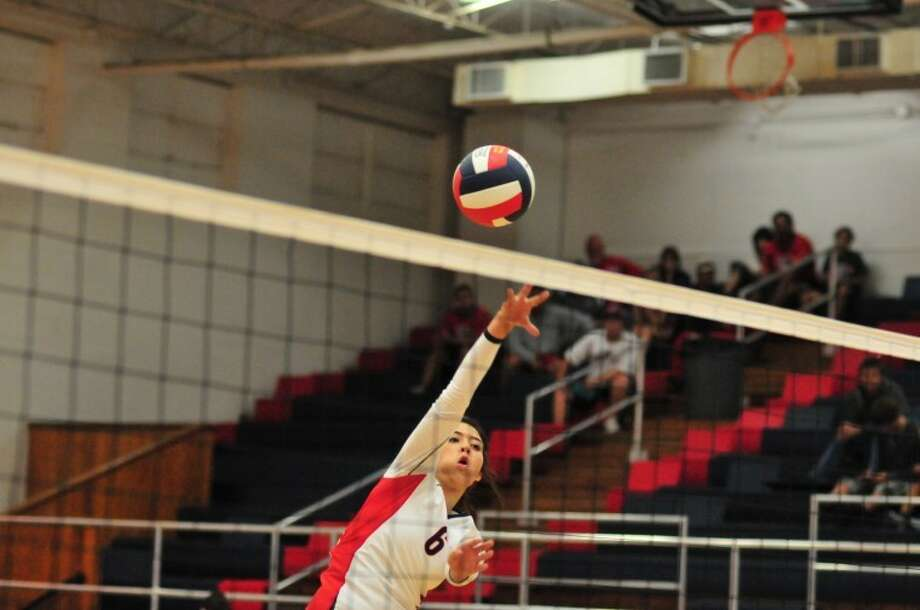 The Plainview Lady Bulldogs' Shalee Bennett hits the ball over the net during a recent match at the DogHouse.
