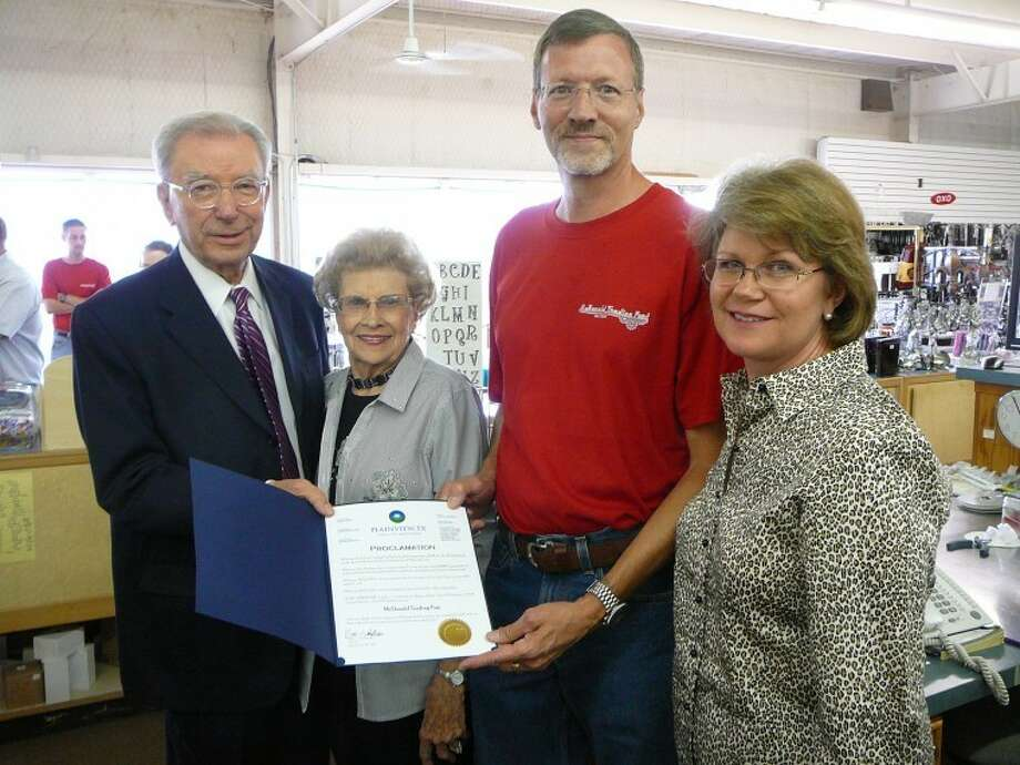 Mayor John C. Anderson (left) presents a proclamation to Evalene McDonald and David and Doris McDonald upon the 75-year anniversary celebration Thursday of McDonald Trading Post and Evalene's Gifts & More.