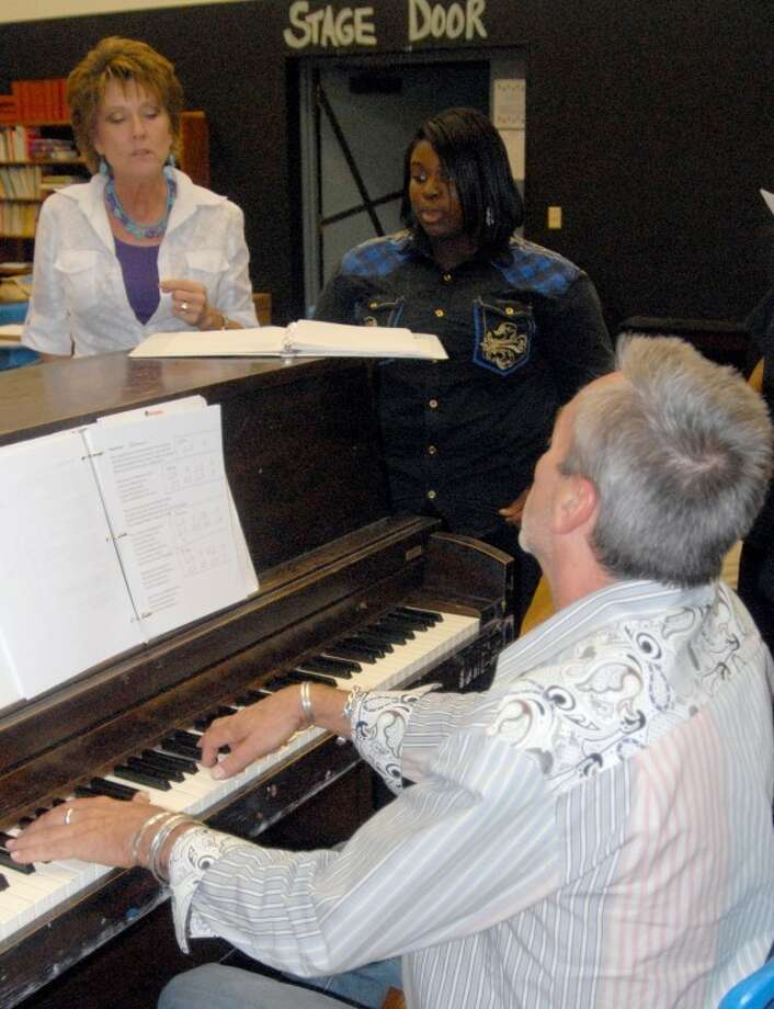 "Richard Porter/Plainview HeraldPracticing for the second annual ""Love Will Build a Home"" concert Thursday night are (clockwise) Martin Duckett) at the piano and vocalists Susan Browning and Jamécia Taylor; Chris Moore (below right), Christion Draper and Sandra Tolson and Tate Greer (leftt), Susan Browning, Jamécia Taylor, Sandra Tolson and J-ven Brooks, and practice for the Habitat for Humanity benefit Thursday at Harral Auditorium. Tickets are available at the door or in advance from Hope English at the Trinity Building, Ninth and Utica."