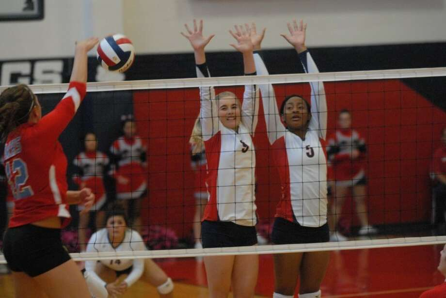Lady Dogs Shannon Watson (9) and Taivia Hearn (5) go for the block during their recent win over Lubbock Monterey. Plainview returns to district action Tuesday as they head to Lubbock High. Photo: Homer Marquez/Plainview Herald