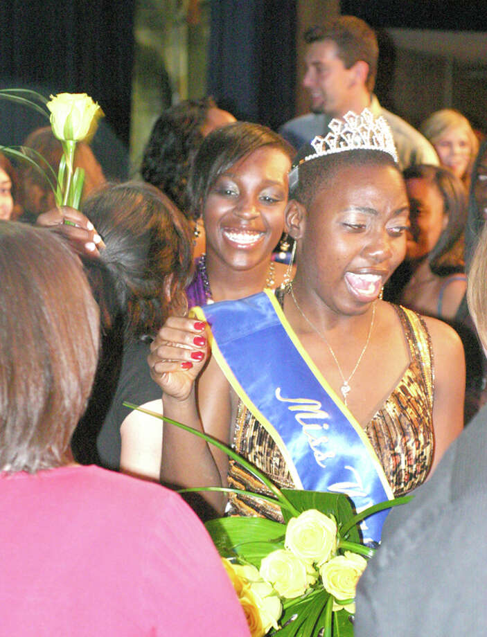 Wayland Baptist University junior Dananai Semwayo was crowned the 41st Miss Wayland on Saturday night at the Miss Wayland Scholarship Pageant held in Harral Memorial Auditorium. Here, the junior from Miami, Fla., is mobbed by friends. Photo: Wayland Baptist University Photo