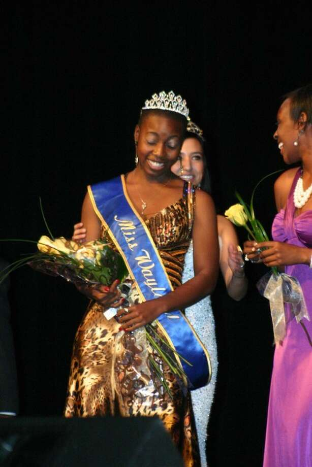 Dananai Semwayo was crowned Miss Wayland 2012 Saturday night at the 41st Miss Wayland Scholarship pageant. Semwayo, a junior political science major from Miami, Fla., was crowned by Jovanna Barrera, Miss Wayland 2011 (behind). Janelle Durrough, second runner-up, also is pictured.