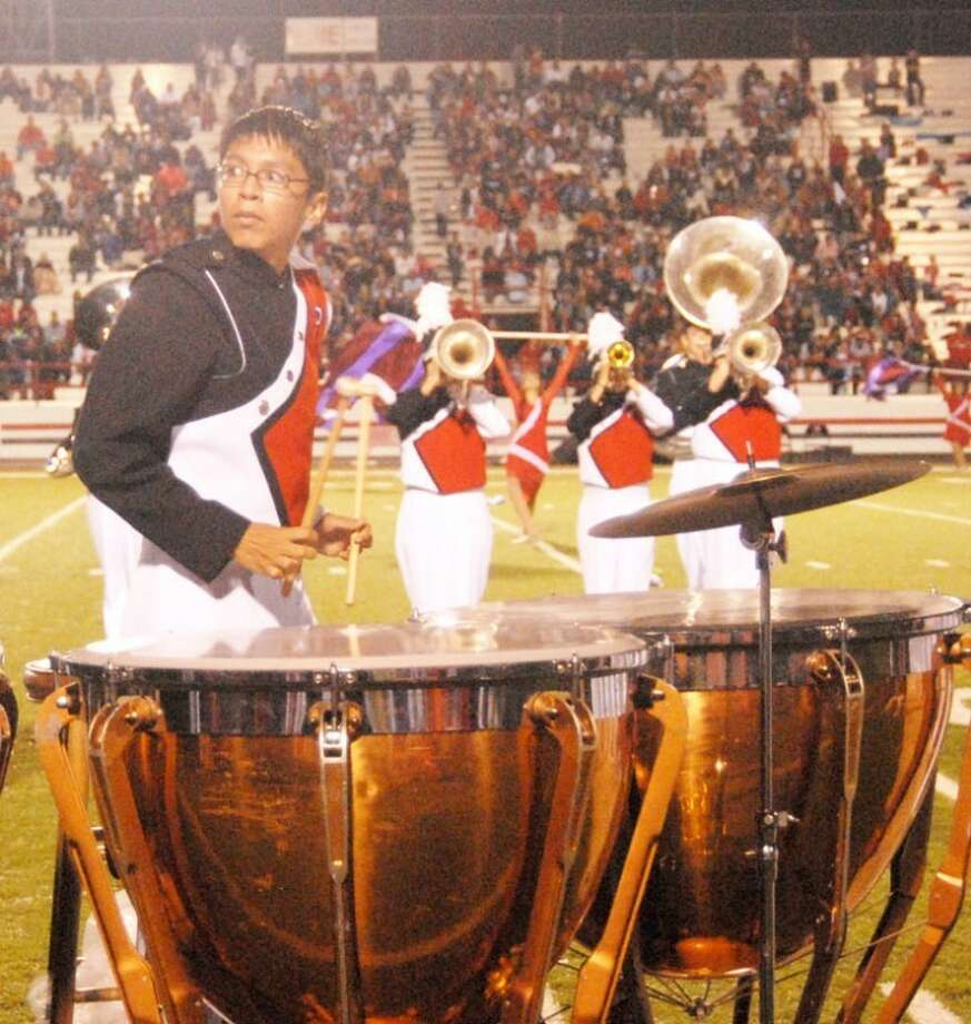 Steven Moya, a member of the percussion section in the Plainview High Powerhouse of the Plains Band, performs on the timpani drums at Friday's halftime performance during the PHS-Dumas football game. Photo: Doug McDonough/Plainview Herald