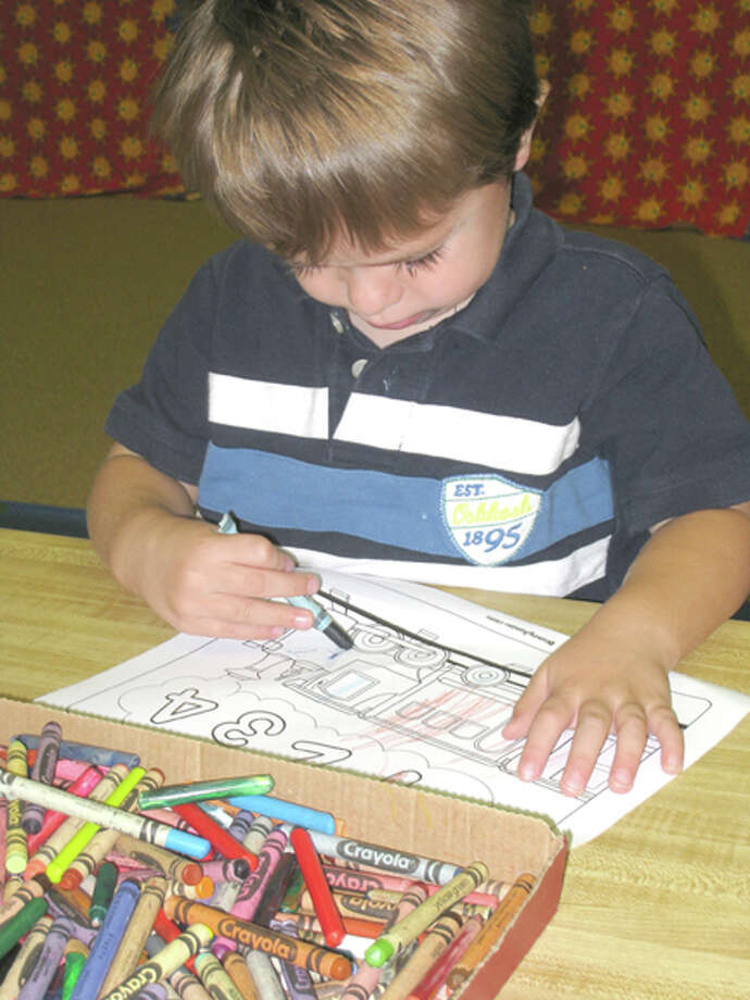 John Sigwald/Unger LibraryDerek Ramirez, son of Nicki Ramirez, colors a train during pre-school story time for 3-5-year-olds at Unger Library, held from 10-10:45 a.m. every Wednesday during the school year. The free program features reading and craft activities. (See more photos at www.MyPlainview.com.)
