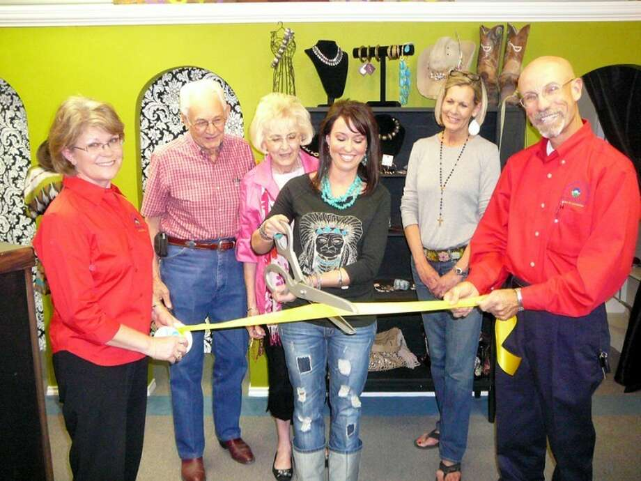 Andrea Glenn cuts the ribbon at a ceremony Thursday at the Rusty Rose Boutique, which offers clothing, jewelry and accessories from 10 a.m.-6 p.m. Tuesday-Saturday at 2302 W. Fifth. Also pictured are Doc and Mary Helen Cross, grandparents to Andrea's husband Dustin, and her mother-in-law Tonya Keesee, along with Chamber of Commerce representatives Doris McDonald (left) and Kenneth Hooper (right).