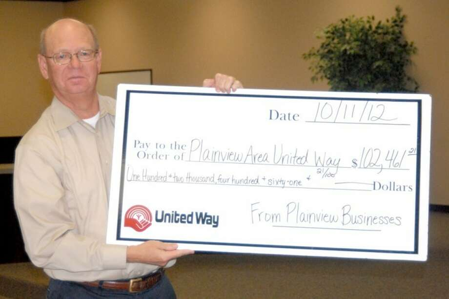 Mike Fox, campaign chairman for the Plainview Area United Way, displays a $102,461 check during Thursday's report meeting, representing that the drive stands at 24 percent of its goal after its first report meeting. The next report meeting will be held in conjunction with the Atmos Chili Cookoff and Fundraiser on Oct. 27. Photo: Doug McDonough/Plainview Herald