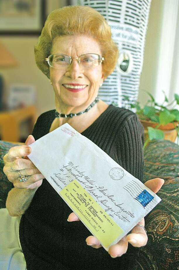 Evalene McDonald shows a letter she mailed 10 years ago this month requesting a catalog from the International Floral Design Center in Dallas. The letter was returned by the post office last week. Photo: Gordon Zeigler