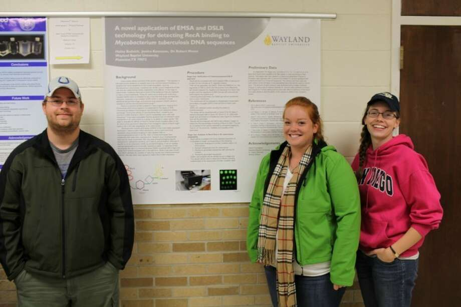 Jonathan Petty/Wayland Baptist UniversityWayland students Rick Ross (left), Hailey Budnick and Jessica Kenneson stand next to a poster that was presented by Budnick and Kenneson at a recent research conference dealing with science, technology, engineering and mathematics. Budnick and Kenneson won second place for their presentation. Ross took second place for his mathematics talk dealing with graph theory. Photo: Courtesy Photo
