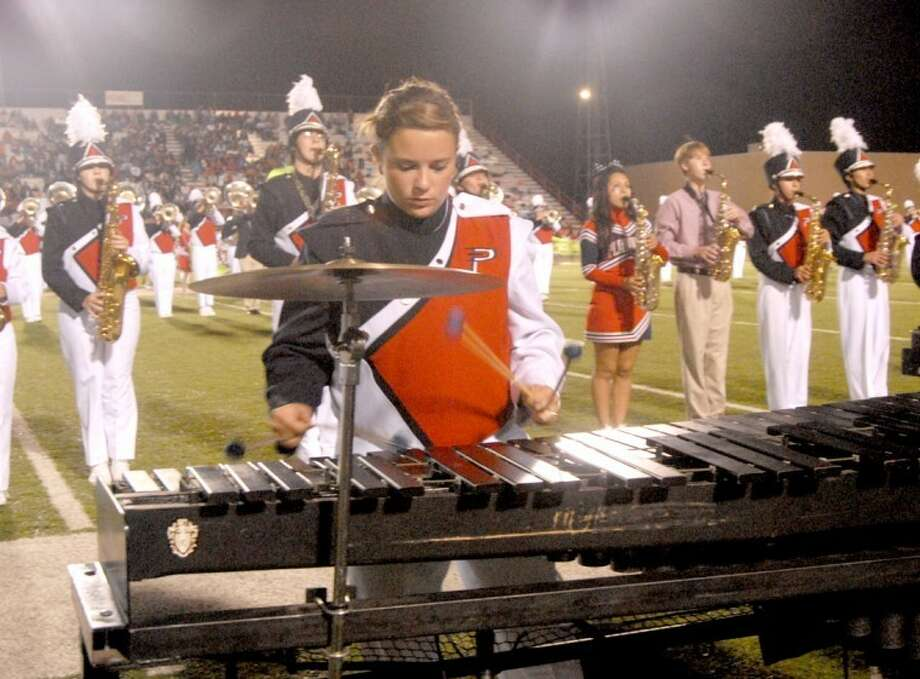 M'Kenna Decker performs on the xylophone during the Plainview High School Powerhouse of the Plains Band performance during halftime of the PHS homecoming game on Sept. 28. The band will perform Saturday during the Plainview Pioneer Marching Championship in its last contest-style event prior to Regional UIL Marching Contest the following weekend. Photo: Doug McDonough/Plainview Herald