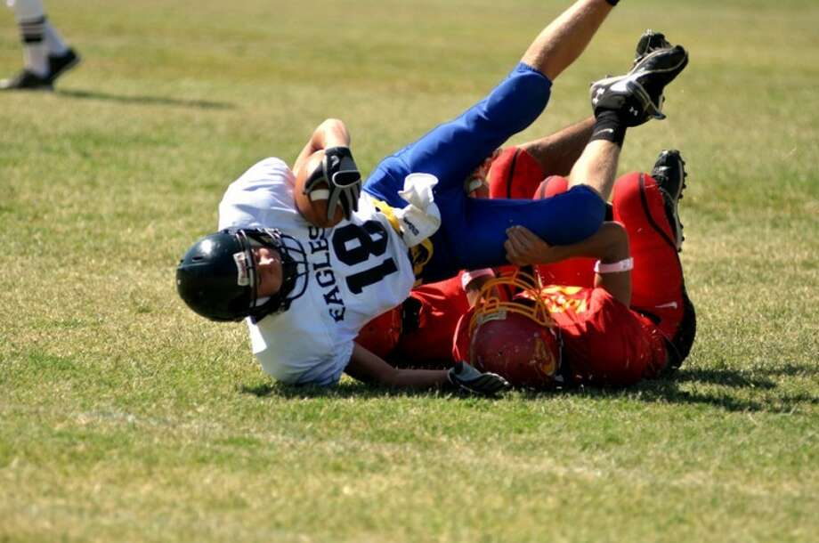 Austin Hendricks (18) takes a tumble after being tackled during Plainview Christian's game Saturday against Holy Cross. The Eagles lost their first game of the season 51-6.