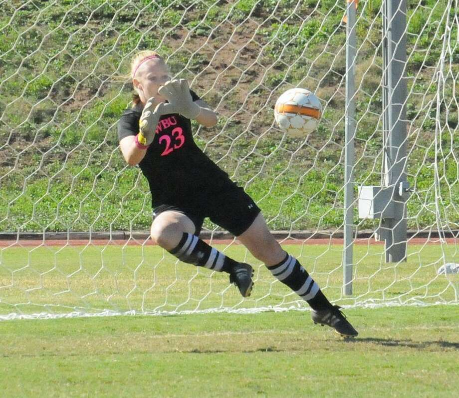 Wayland goalkeeper Courtney Chambers makes a save on a penalty kick in Saturday's match against Rogers State. The Pioneers lost, 2-0. Photo: Kevin Lewis/Wayland Baptist University