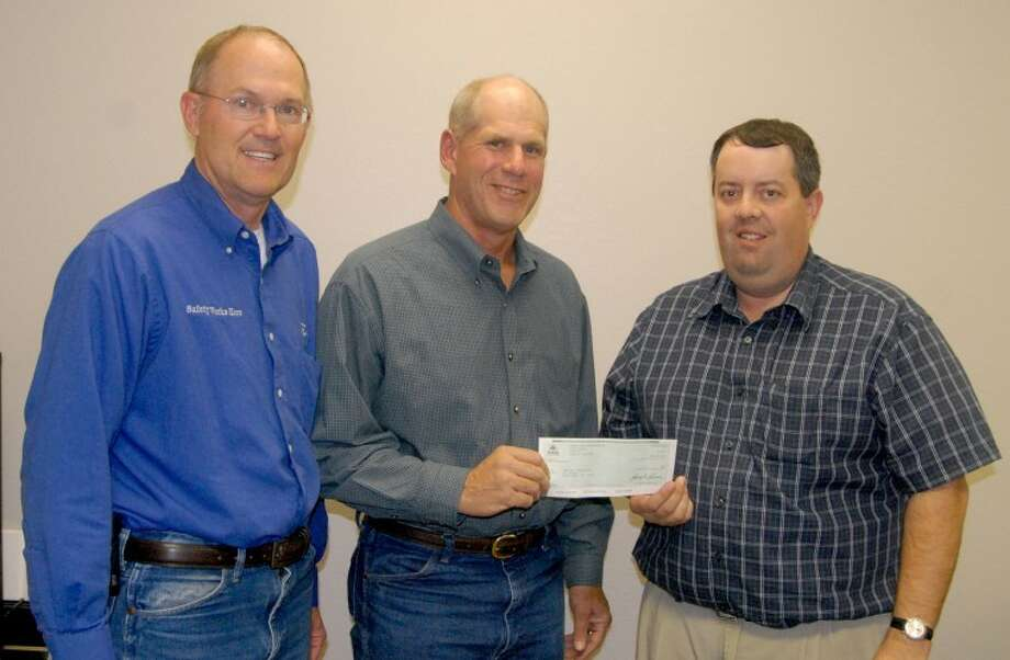 Richard Porter/Plainview HeraldLeon Heinen (left) and Bill Buxton with Pioneer Hi-Bred present a $1,000 check to Plainview YMCA Executive Director Rob Wilkerson for the Y's Strong Kids campaign. The donation will help expand the organization's programming for youth and low-income families.