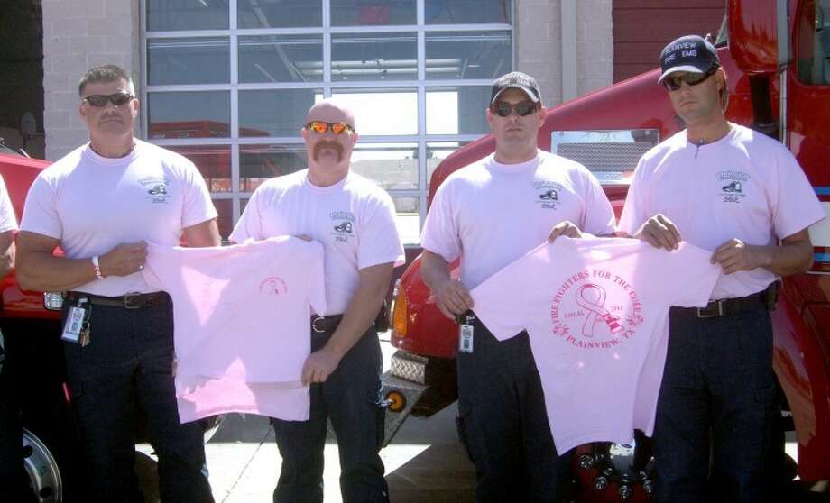Members of the Plainview Fire Department and EMS — including Lt. Bobby Gibson (left), Bryan Merrick, Joe Marks and Carson Johnson — will be wearing pink T-shirts through October in recognition of Breast Cancer Awareness Month. T-shirts are available at Station #3, 3405 S.W. Third, for $10. Proceeds go to the Susan G. Komen Foundation. Photo: Jessica Thornton/Plainview Herald