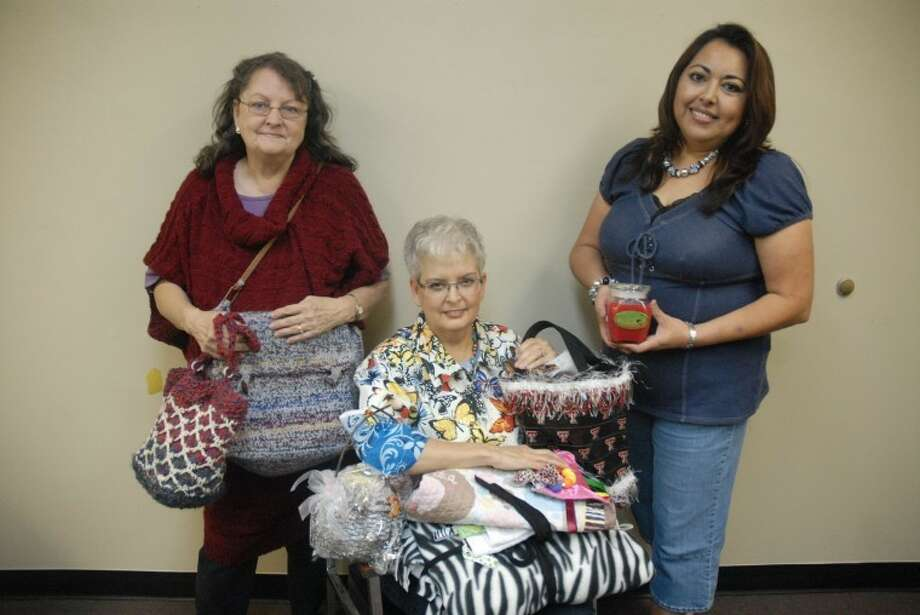 Ryan Thurman/Plainview HeraldCelia Drager (left) holds her hand-knitted and crocheted purses while Barbara Bell displays fleece blankets, bags, flip-flops, beaded scarves and mittens, and hair ribbons. Sonia Medina will have candles, oil warmers, hair bows and jewelry at the 37th annual Running Water Draw Arts & Crafts Festival, which will be held Friday through Sunday at the Ollie Liner Center. Sponsored by the Plainview Rotary Club, admission is $2 for adults and $1 for children.