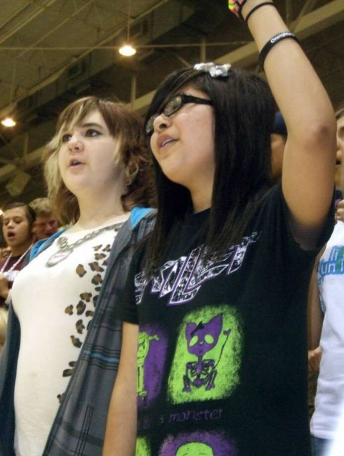 Thirteen-year-olds Savannah Wright (left) and Mirabel Magallanes sing during Thursday evening's session of the Plainview Area Go Tell Crusade. The fifth night of the event, held over from Wednesday, drew more than 1,000 people to Hutcherson Center, where the crusade will wrap up at 7 p.m. Sunday. Tonight, the crusade will join with the Fifth Quarter following the Bulldogs' football game with Randall at Greg Sherwood Memorial Bulldog Stadium. (See video.) Photo: Kevin Lewis/Plainview Herald