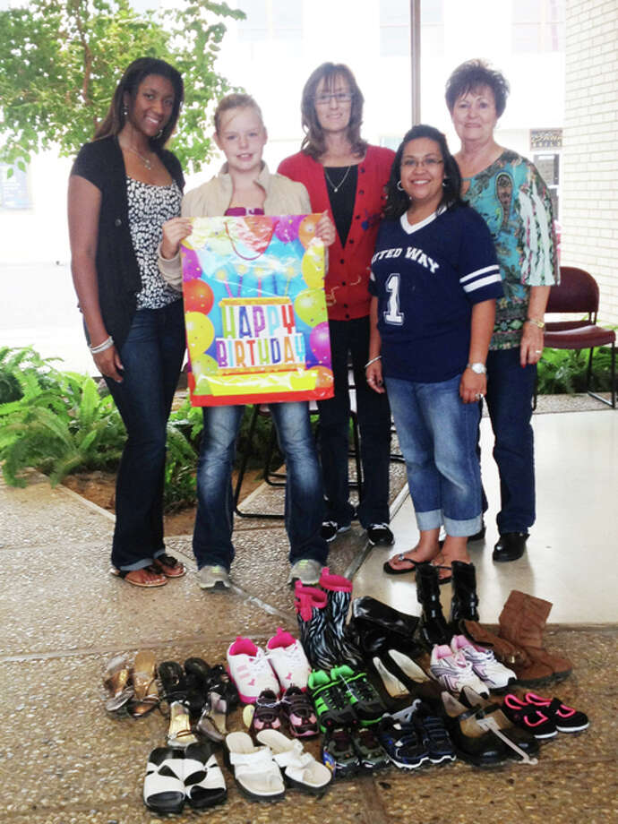 The staff of the Hale County Crisis Center are shown with Zoey Burt and the shoes she collected. From left to right: Til-lois Fifer, Zoey Burt, Marci Brown, Stephanie Godino and Kay Harris, director. Photo: Courtesy Photo | Dawn Burt