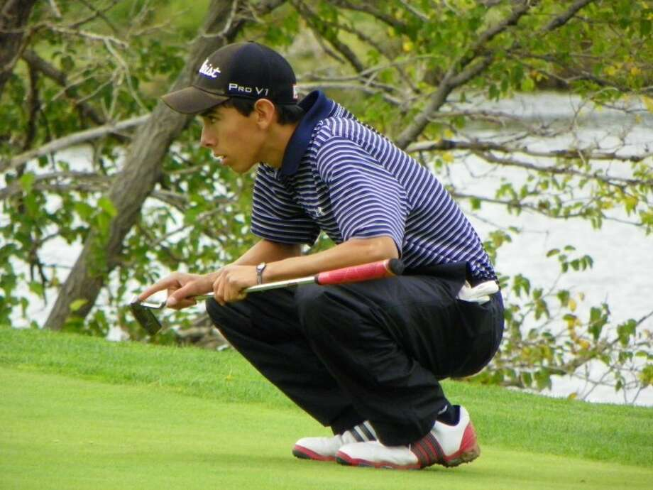 The Plainview Bulldogs' Tim Gonzales reads the green during the Canyon Triangular on Saturday at Palo Duro Creek Golf Course. Gonzales shot a career-low 70 to lead the Bulldogs. Photo: Courtesy Photo By Betsy Lewis