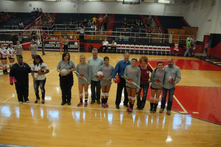 Parents join Plainview seniors Dee Whitaker, Shannon Watson, Michelle Portillo, Shania Dulakis and Kymber Carroll as they were honored during Tuesday's Senior night ceremony at the Dog House. Photo: Homer Marquez/Plainview Herald