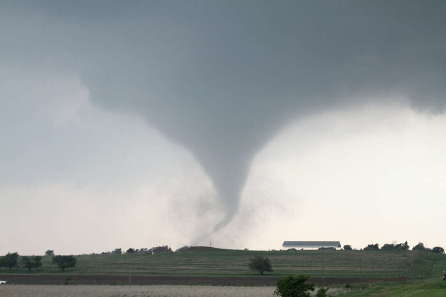 This tornado near Chickasha, Okla., was photographed May 24, 2011, by Bruce Haynie, an avid storm chaser of 25 years. Haynie works as an electronic system analyst at the National Weather Service office in Lubbock. Photo: Bruce Haynie/Courtesy Photo