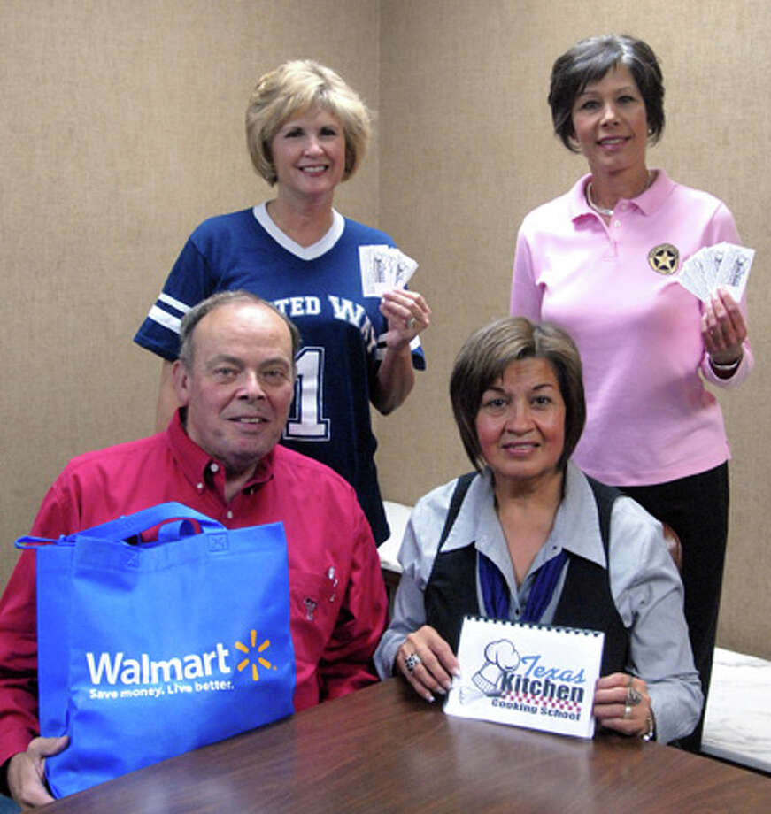 Richard Porter/Plainview HeraldRichard Purcell and Lydia Castillo (seated right) of the Plainview Rotary Club show a Walmart bag and cookbook that will help fill goodie bags that will be handed out to each attendee at the Texas Kitchen Cooking School on Thursday. Nancy Stukey (standing right) of Happy State Bank and Vernah Ramsower-Sprous of the Plainview Herald hold tickets available for $8 a person at Happy State Bank or the Herald. Doors will open at 5:30 p.m. and the show will begin at 6:30 at the Ollie Liner Center.