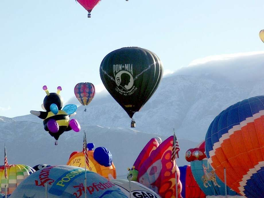 The annual Albuquerque International Balloon Fiesta wrapped up its nine-day run Sunday. Here, balloons lift off in front of snow-capped mountains.