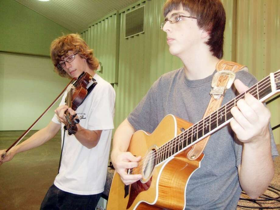 Jordan Hackett (left) and his brother Jacob entertain during the Hale County Farm Bureau's annual meeting Tuesday evening at the Ollie Liner Center. Jordan is a freshman at Wayland and Jacob is a sophomore at Plainview Christian High School. They are the sons of Brent and Leslie Hackett. Photo: Kevin Lewis/Plainview Herald