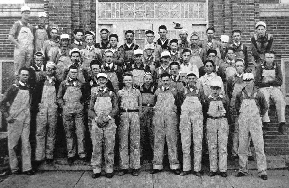Wearing matching outfits of blue and white striped overalls, green shirts and white painter's caps, the I.S.D. Fraternity served as an all-male pep squad for PHS during the 1927-28 school year. Photo: 1928 Plain View