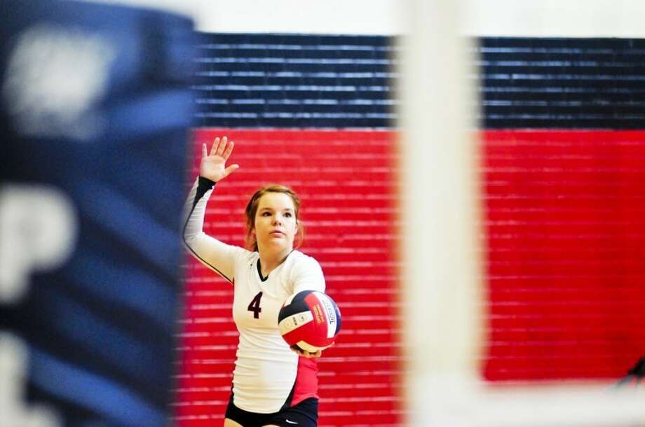 Plainview Bulldog senior Halley Hatch prepares to serve during a District 3-4A match against the Palo Duro Lady Dons on Saturday in the DogHouse. Photo: By RYAN THURMAN