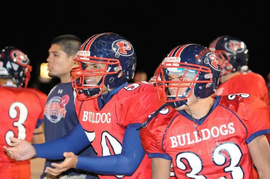 Plainview Bulldogs (50) Angel Ornelas and Isaiah Carrasco react to penalty call during the Dogs' recent game against the Monterey Plainsmen. Plainview returns to district action next Friday as they head to Hereford to take on the Whitefaces. Photo: Richard Porter For The Plainview Herald
