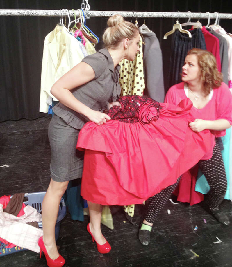 "Maranda Ball and Cadee Britton struggle with an excess of clothes in ""Off the Rack."" Photo: Courtesy Photo"