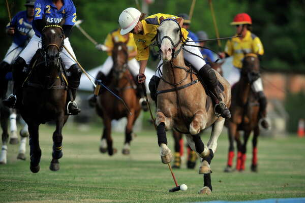 Hannah Reynolds with Bloomfield reaches back to hit the ball as Las Vinas players chase during the Veuve Clicquot Challenge Tournament Finals at the Saratoga Polo grounds on Sunday, July 24, 2016, in Greenfield Center, N.Y.  The next tournament is July 29th at 5:30pm.  (Paul Buckowski / Times Union)