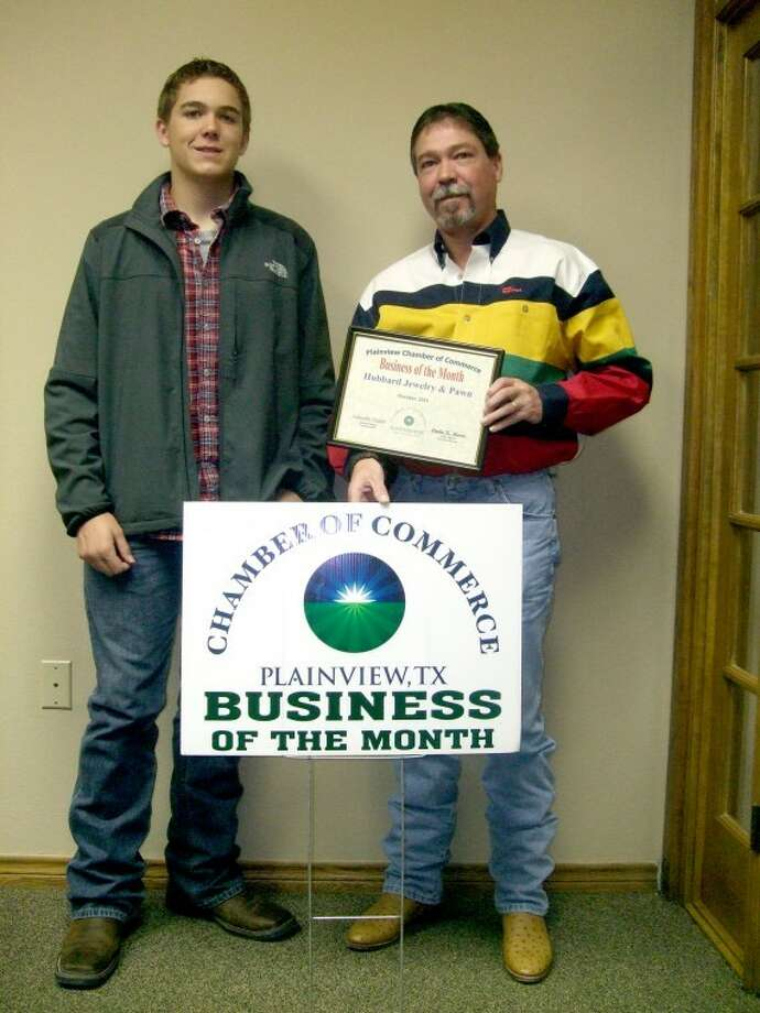 Rick Morton and his son Tanner pose with the Plainview Chamber of Commerce Business of the Month sign and certificate presented to Hubbard Jewelry and Pawn at this morning's board meeting. Hubbard's, 1511 W. Fifth, was started more than 75 years ago by Lloyd Hubbard and has been in the Morton family since 1978.
