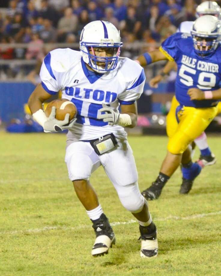 Olton Mustangs running back Billy Ross looks for running room against Hale Center. Ross and quarterback Tommy Guerrero led the Mustangs to a 47-6 rout of the Owls. This week they will need another solid performance to try to upend unbeaten Sundown. Photo: Albert Gomez/Hale Center American/Olton Enterprise